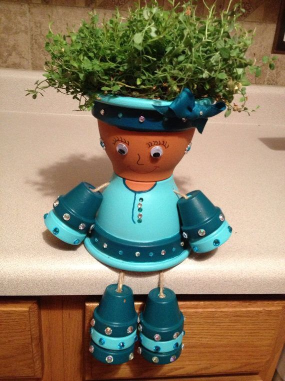 17 best images about bloempot poppen pot people on for Small terracotta pots crafts