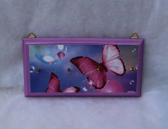 Pink butterfly decoupage key rack on a blue background