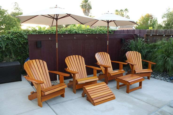 Think of your patio as an outdoor room. It is a transitional space where you can enjoy the outdoors while having access to indoor comfort. Add comfortable Adirondack chairs and umbrellas to complete the space.