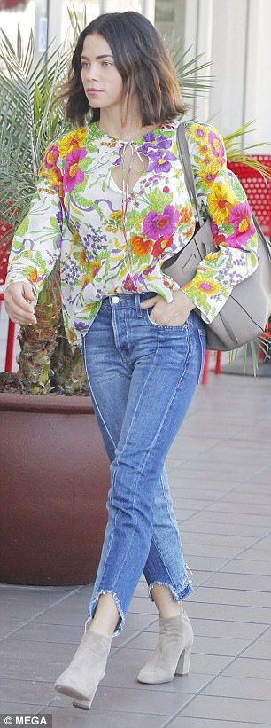 Strutting her stuff: The Step Up star tucked her cute top into blue jeans with a raw hemli...