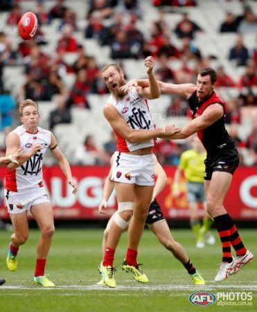 Matthew Leuenberger of the Bombers contests the ruck against Max Gawn of the Demons during the 2016 AFL Round 02 match between the Melbourne Demons and the Essendon Bombers at the Melbourne Cricket Ground, Melbourne on April 2, 2016.