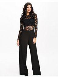 http://nelly.com/se/kl%C3%A4der-f%C3%B6r-kvinnor/kl%C3%A4der/jumpsuit/john-zack-911/lace-back-zip-jumpsuit-911243-14/