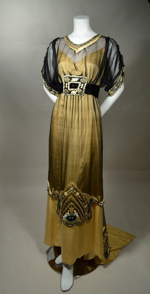 1910'S vintage evening gown from JAMES CAMERON'S TITANIC. Butter yellow silk satin with black marquisette overdress. Yellow, blue and black silk embroidery. An authentic period gown that has been painstakingly restored./ RP Vintage