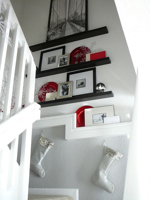easy to change for holiday decorations - By front door?  Or stairs leading downstairs?