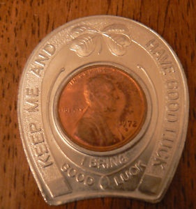 """My gram gave me one of these before she passed away with a penny from her birth year - 1919.  It says """"keep me and you'll never be broke"""""""
