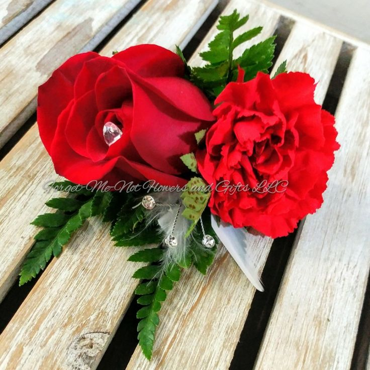 Red rose and carnation Boutonniere for a red glam wedding by Forget-Me-Not Flowers and Gifts