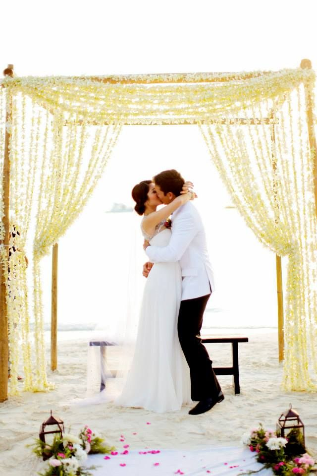 beach wedding in new jersey%0A Beach wedding in Boracay  Philippines with flowers draped to resemble  curtains on the ceremony arch