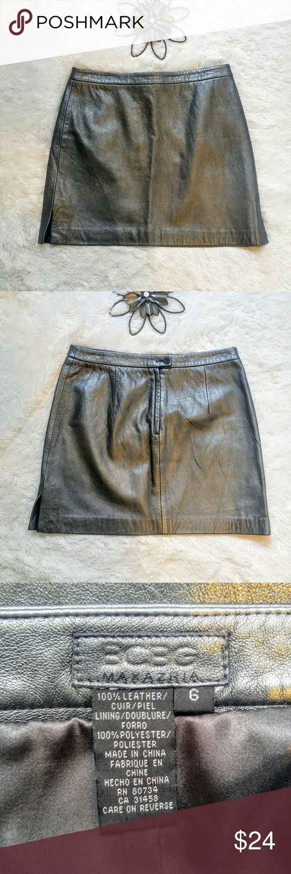 BCBG Metallic Charcoal Leather Skirt size 6 NWOT Real leather skirt in charcoal metallic color. Button/zip back. No holes stains or flaws.  Super fast same day or next business day shipping. Offers always welcomed. Thanks for looking! BCBGMaxAzria Skirts Mini