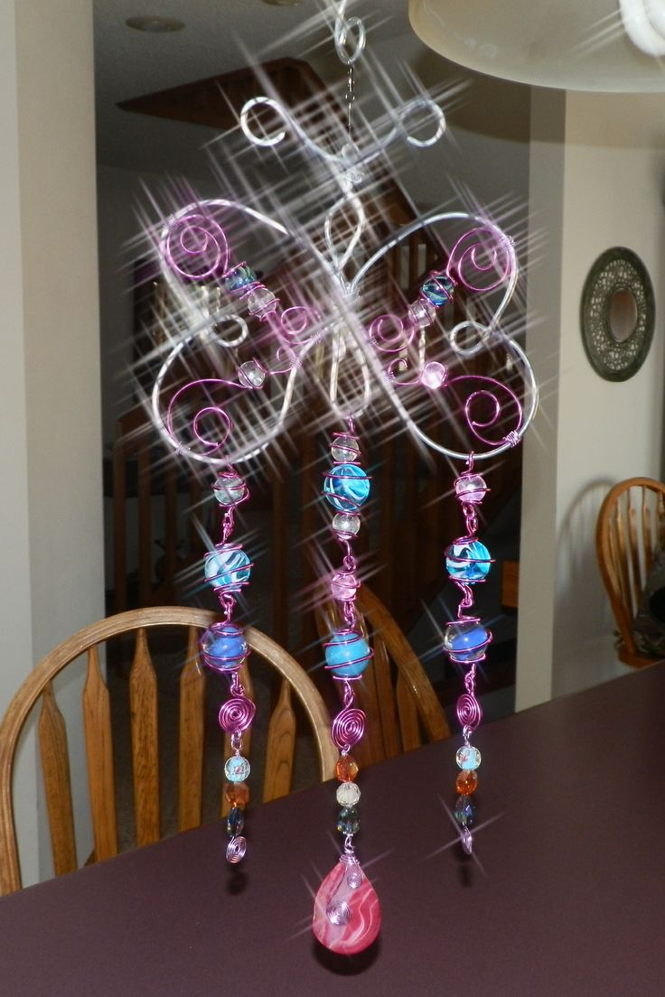 Butterfly sun catcher; wind chime; wire wrapped marbles and beads; garden art.