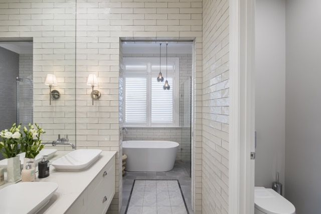 Love the seperate spaces for bath/shower/toilet Love full wall of tiles