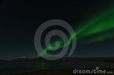 Northern Light in Greenland with a reflect on a fjord