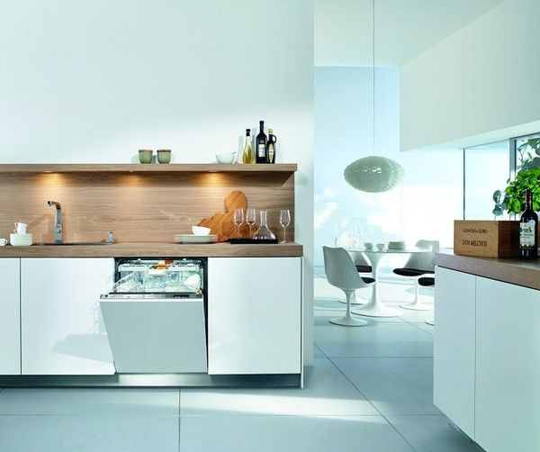 This white Miele model is designed to blend seamlessly into white kitchen cabinetry. The brand's patented Knock2Open technology does away with handles, allowing for a completely flush facade that users can tap twice to gain access. It comes equipped with an adjustable cutlery tray and interior LED lights, and it automatically recognizes how full the load is and adjusts energy and water use accordingly. It's also one of the quietest dishwashers available at 38 decibels.