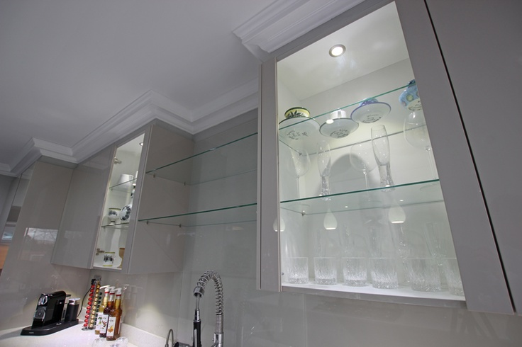 Whether clear or frosted, glass shelving is not only an elegant accent for a kitchen but glass fronted doors create an illusion of extra depth, making a kitchen space feel larger than it is.  As demonstrated within this design by LWK Kitchens, the impression of a larger space can be further emphasised with spotlights directed onto the glass so the light reflects off it and back across both the shelving and units.