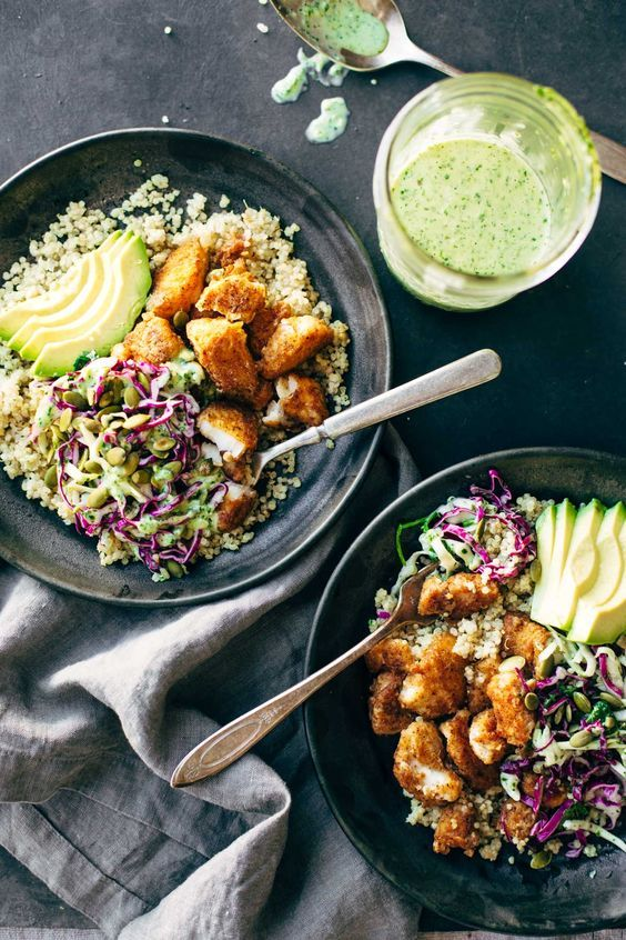 Spicy Fish Taco Bowls with cilantro lime slaw - crispy, fresh, and SO yummy! quinoa, slaw, avocado, and crispy fish! | pinchofyum.com