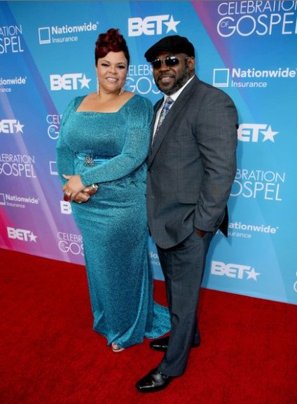 This is one my favorite pictures of Tamela and David Mann.  Two reasons why is #1 Tamela Mann usually wears black and as you can see she is in a different color.  #2 David Mann is  bad man with them shades on.  I love the way he always color coordinates with his wife.