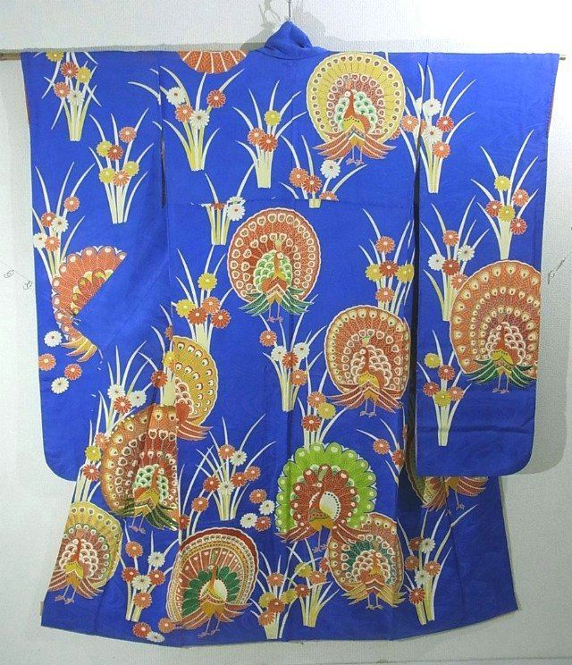 This is a glamorous Furisode Kimono with vibrant peacock and 'Kiku'(chrysanthemum) pattern, which is dyed.