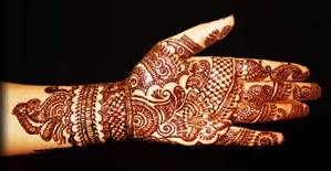 henna: its an ink non permanent tattoo Hindus wear it for special occasions like weddings. It means different things like good luck or happy marriage. It relates to identity as it is part of a ritual they do.