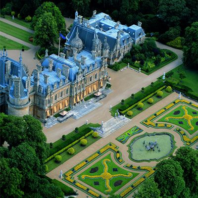 Waddesdon Manor with sky blue roofs in Buckingham, England. An astonishing Renaissance-style château designed by French architect Destailleur in 1874 for Baron Ferdinand de Rothschild.
