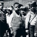 Hans Massaquoi describes his childhood and youth in Hamburg during the Nazi rise to power. His biography provides a unique point of view: he was one of very few German-born biracial children in all of Nazi Germany, shunned, but not persecuted by the Nazis.