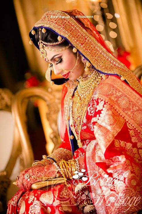 Dramatic Bengali Bride in Red Silk Saree with Touches of Blue