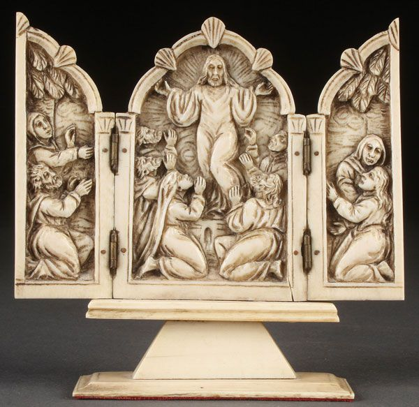 CARVED IVORY TRIPTYCH OF THE ASCENSION, 19TH CENTURY. The central panel with a relief carved depiction of Christ ascending to Heaven as his disciples look on, within an ogee arched frame. The hinged wings similarly carved with onlookers amidst palm trees and resting on an integral raised plinth. Height 4.1 inches.  Auction Price Realized: $813.00