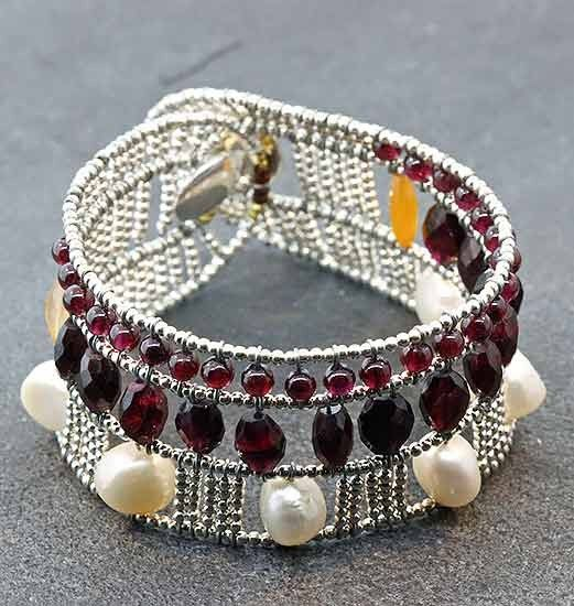 """Ziio Netti Garnet Bracelet - Sterling silver, garnet, cornaline, freshwater pears and Murano glass bead Netti bracelet.  8"""" in length by 1 1/4"""" wide."""