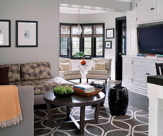 Our tip for mixing patterns: keep the color scheme simple. Find more living room inspiration: http://www.bhg.com/decorating/color/schemes/living-room-color-schemes/#page=15