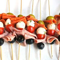 Antipasto Kabobs -- Must do for next wine gathering... Add prosciutto and some fancy cheese though :)