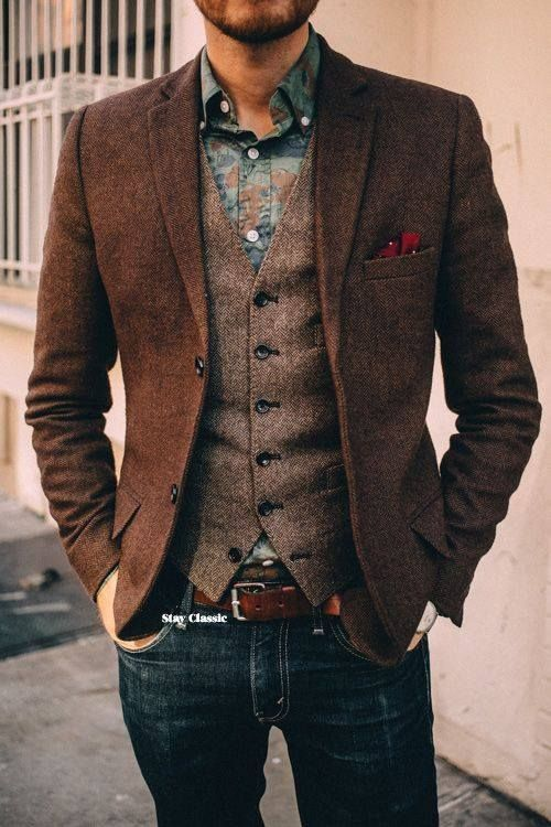 Stylish men's layering with jeans and vest: