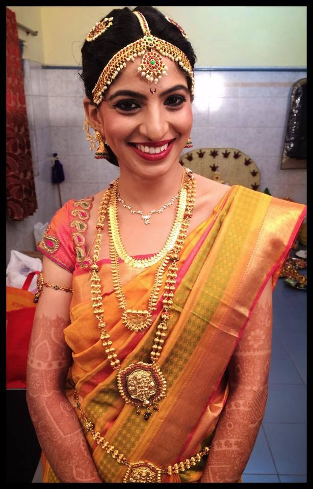 Traditional South Indian bride wearing bridal saree and jewellery. Muhurat look. Makeup by Swank Studio. #southindian #wedding #hindu #tamil