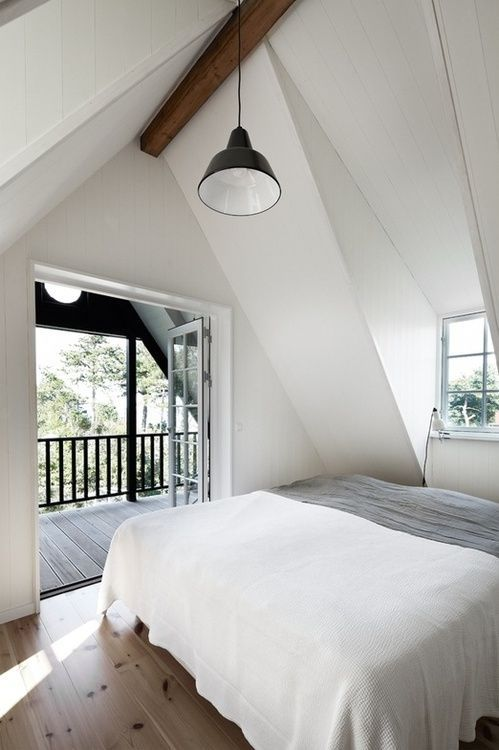 bedroom. with a pitched roof