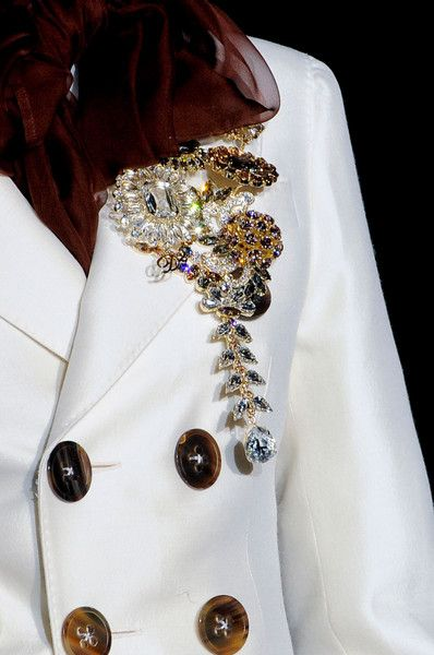 Dsquared² Fall 2013 - Details- brooches! Lov them and for me never out of style@!