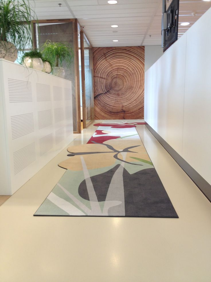 customised carpet welcomes guests and lead them to the right direction