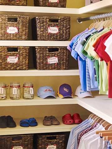 Organized Kid's Closet ~ Labeled baskets for socks and jars for coins keep a kid's closet tidy. Dual rods maximize clothing storage and make it easy to separate play clothing from special occasion clothing.