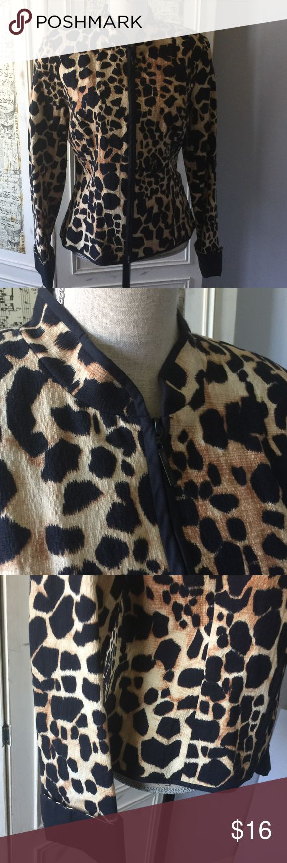 """Maggy London Animal Print zip up jacket Sz 12 Maggy London Women's Animal Print zip up jacket Sz 12.  This beautifully made animal print jacket is a great staple for your closet and will never go out of style. It has a very slimming line.. Front zipper.  Fully lined. It is very comfortable and has stretch as it's 98% cotton and 2% spandex.  Lining is 100 acetate.  Perfect condition, no damage.  Measures 24"""" in length. Bust approx 38"""", Waist approx. 37"""". Hem across bottom approx. 38""""…"""