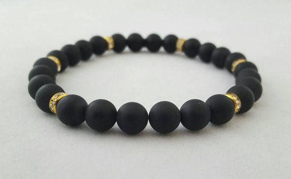 Handmade matt onyx semiprecious beads with gold rhinestone spacer beads bracelet Pictured bracelet suits wrist size up to 21cms   Please email on craftypapilio@gmail.com for any further information or bespoke sizes  Every bracelet will be packaged individually in an organza bag. if you required it boxed for a present please email us for further details  Shipping, zero posting value for every additional item