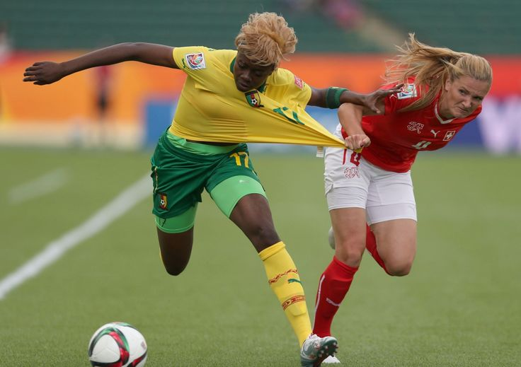 Cameroon's Gaëlle Enganamouit tussles with Rachel Rinast from Switzerland in the Women's World Cup 2015