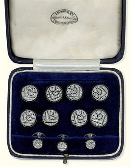 AN ART DECO ONYX AND DIAMOND DRESS-SET  Comprising cufflinks designed as a pair of onyx discs with applied openwork rose-cut diamond geometric centre panels, four dress-buttons and three shirts studs, circa 1925, with French assay marks for gold, in later fitted case (9) Sold for $9,031