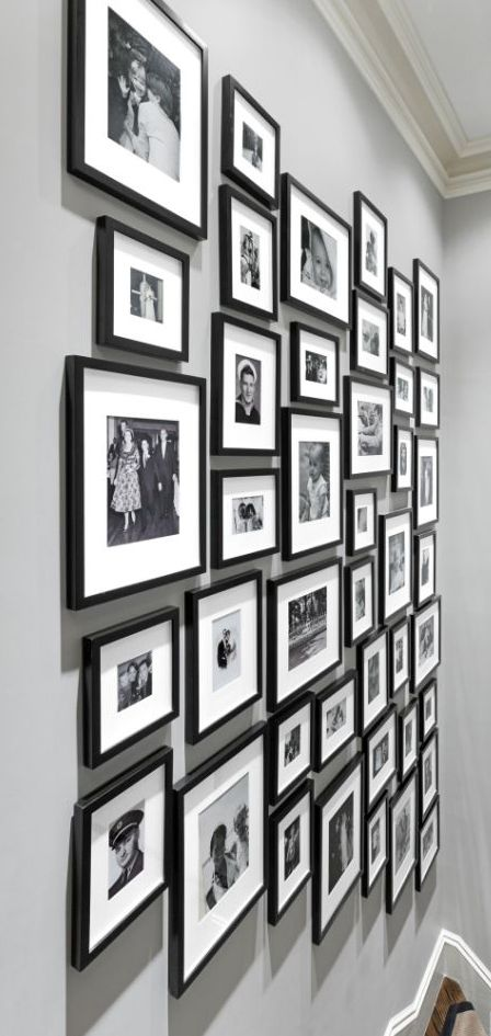 A gallery wall is the perfect place to feature photos from your family's history. Matching frames and black and white photos to create a stunning, multigenerational gallery wall. --------------------------- #galley #wall #home #decor #family #picture #frames #custom #framing