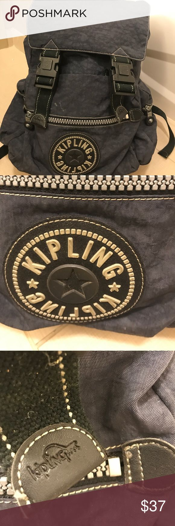 LARGE 💯 authentic KIPLING BACKPACK DEAL OF THE DAY!!!In very good condition - small stain. On front. - probably could be washed out . This dusty blue color is fantastic with all the bells and whistles Kipling comes with . Used very little as it was too big for my daughter. I used a couple of times and love the toggle close inside and the extra large pockets on sides and front large pouch . Priced well below what it should be. Kipling Bags Backpacks