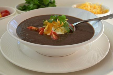 Here is the Haitian version of black bean soup (Sauce Pwa). It has a creamy savory flavor and is typically served with white rice.