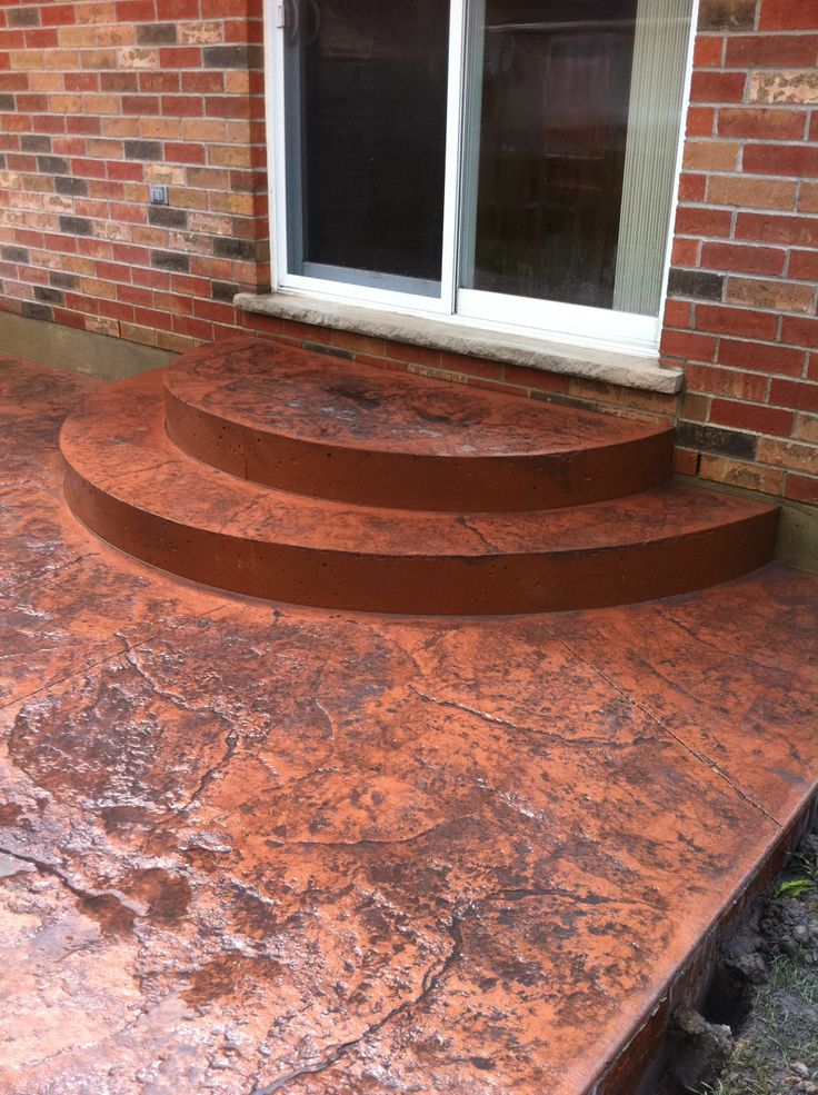Rough cut stone stamped concrete semi circle steps in for Semi concrete house
