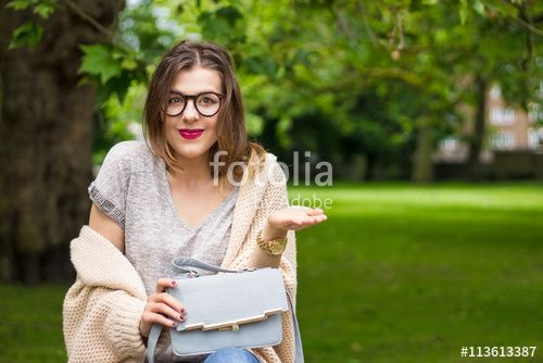 Happy girl with raised hand