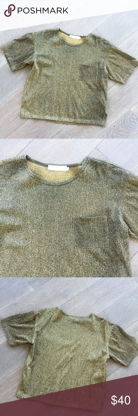 Vintage Black&Gold Metallic Boxy T-Shirt Vintage Black&Gold Metallic Boxy T-Shirt, women's size Medium. Fits Boxy/oversized. In perfect vintage condition, almost wouldn't know it was vintage at all! Front pocket, cute with black jeans or culottes. Vintage Tops Tees - Short Sleeve