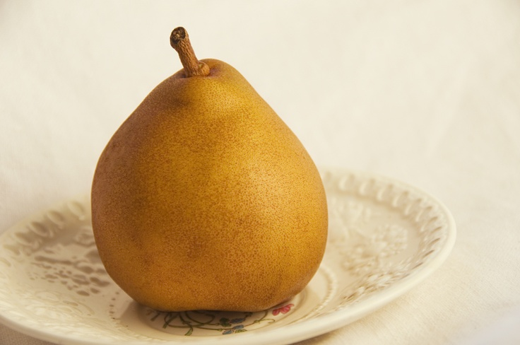 a pear on a plate my great grandmother bought.