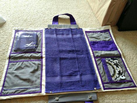 Bolsa de pañales con toallas y telas varias