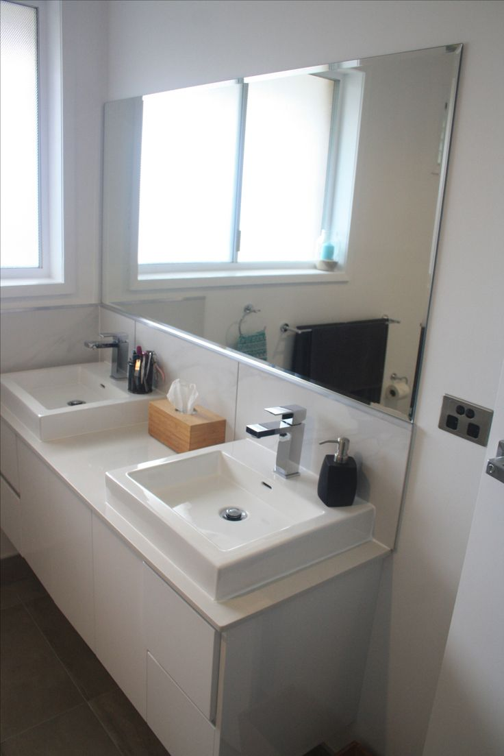 Re-purposed white stone vanity top on new Harper's vanity. White and grey main bathroom