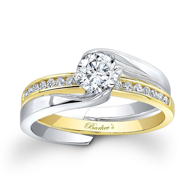 51f649365 This two-tone gold diamond bridal set features a round diamond center with  an interlocking shank. The yellow gold band sports diamonds that can be  worn ...