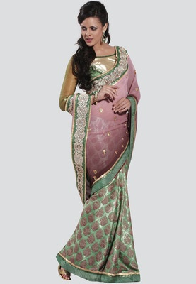 A green coloured saree for women by Bahubali. Made from crepe and jacquard, this saree measures 5.50 metres and comes with blouse piece measuring 0.90 metres. Bahubali offers this pretty saree that will surely make you the cynosure of all eyes. Made from crepe and jacquard, this green and pink coloured saree features a beautiful self pattern that makes it look very elegant and appealing.