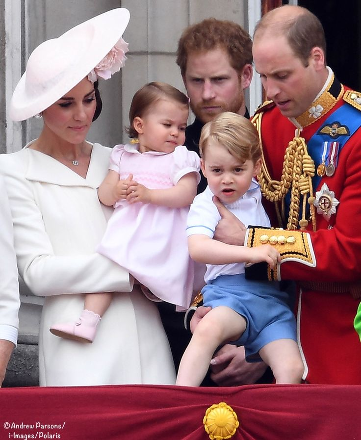 Catherine, Duchess of Cambridge, Princess Charlotte, Prince George and Prince William, Duke of Cambridge stand on the balcony during the Trooping the Colour, this year marking the Queen's official 90th birthday at The Mall on June 11, 2016 in London, England.